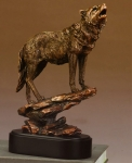 Bronze Finish Wolf On A Rock Sculpture